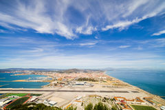 Gibraltar Airport Runway and La Linea Town. Gibraltar airport runway, La Linea de la Concepcion town in Spain at the far end, Mediterranean Sea on the right royalty free stock image