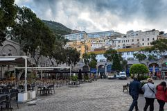 Casemates square with bars and restaurants in center of Gibraltar city. GIBRALTAR - DECEMEBR 2017: Casemates square with bars and restaurants in center of Royalty Free Stock Photo