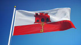 Gibraltar flag in slow motion seamlessly looped with alpha. Gibraltar flag waving in slow motion against clean blue sky, seamlessly looped, close up, isolated on stock video