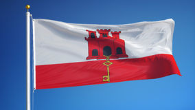 Gibraltar flag in slow motion seamlessly looped with alpha. Gibraltar flag waving in slow motion against clean blue sky, seamlessly looped, close up, isolated on stock footage