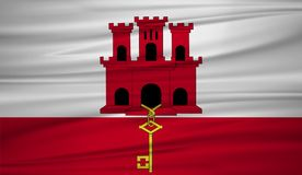 Gibraltar flag vector. Vector flag of Gibraltar blowig in the wind. EPS 10 Stock Image