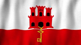 Gibraltar flag waving in the wind. Closeup of realistic flag with highly detailed fabric texture