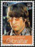 GIBRALTAR - 1999: mostras John Winston Ono Lennon 1940-1980, cantor e compositor fotos de stock