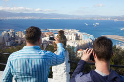 Gibraltar, points of interest in the British overseas area on the southern spit of the Iberian Peninsula,. Gibraltar, monkey rock, tourists takes photos of a stock photos
