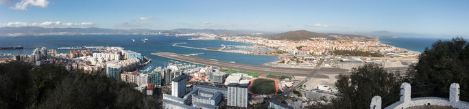 Gibraltar, points of interest in the British overseas area on the southern spit of the Iberian Peninsula,. Gibraltar, view from Upper Rock to the north, airport royalty free stock photography