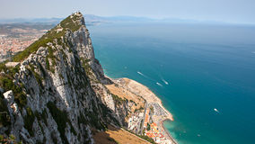 Gibraltar Rock. View from above, on the left Gibraltar town and bay, La Linea town in Spain at the far end, Mediterranean Sea on the right Royalty Free Stock Photography