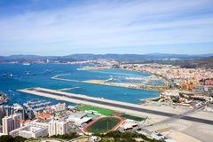 Gibraltar Runway and La Linea Cityscape. Gibraltar airport runway and La Linea de la Concepcion in Spain, southern Andalucia region, Cadiz province Royalty Free Stock Photo