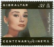 GIBRALTAR - 1995: shows Audrey Hepburn (1929-1993), actress. GIBRALTAR - CIRCA 1995: A stamp printed in Gibraltar shows Audrey Hepburn (1929-1993), actress Royalty Free Stock Photo