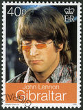 GIBRALTAR - 1999: shows John Winston Ono Lennon 1940-1980, singer and songwriter. GIBRALTAR - CIRCA 1999: A stamp printed in Gibraltar shows John Winston Ono Stock Photos