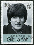 GIBRALTAR - 1999: shows John Winston Ono Lennon 1940-1980, singer and songwriter. GIBRALTAR - CIRCA 1999: A stamp printed in Gibraltar shows John Winston Ono Stock Images