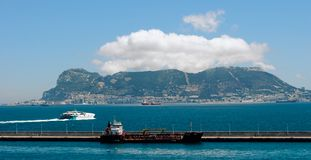 Gibraltar on a sunny day from the bay. Rock of Gibraltar  on a sunny day seen from Algeciras bay, Andalusia, Spain Stock Photo