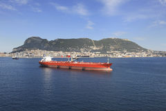 Gibraltar and tanker. Gibraltar with red oil tanker Royalty Free Stock Image