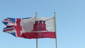Flags of UK and Gibraltar stock video footage