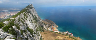 Gibraltar Upper Rock Panoramic. A panoramic view of the Gibraltar upper rock with a view towards Spain and the Gibraltar coastline. The brown colored slope on Royalty Free Stock Photo