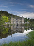 Gibson mill reflection in mill pond Royalty Free Stock Photo