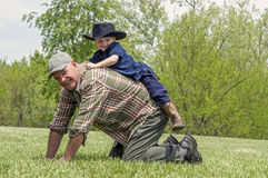 Grandfather playing with grandson portrait Royalty Free Stock Photo