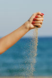 Gießen Sie Sand Stockfotos