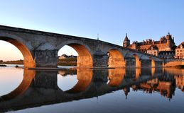 Gien bridge and castle. Scenic view of Gien bridge reflecting on Loire river with Anne of Beaujeu's castle in background, Loiret, France Stock Photography