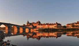 Gien bridge over Loire river. Scenic view of bridge over river Loire in town of Gien with Anne of Beaujeu's castle in background, Loiret, France Royalty Free Stock Image