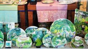 Earthenware crockery in shop window in Gien. GIEN, FRANCE - JULY 9, 2010: hand painted earthenware crockery in outdoor shop window in Gien town. French Stock Photos