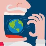 Gieriger Geschäftsmann, der den Weltplaneten isst Lizenzfreie Stockfotografie