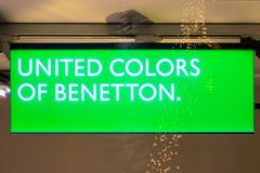 UNITED COLORS OF BENETTON. GIESSEN  GERMANY DECEMBER 2017: Illuminated Logotype of UNITED COLORS OF BENETTON.  UNITED COLORS OF BENETTON is a international Royalty Free Stock Photos