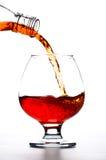 Gietende Cognac royalty-vrije stock afbeeldingen