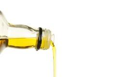 Gietende Olijfolie stock afbeelding