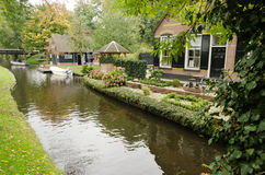Giethoorn. Beautiful traditional house on a small island in a Dutch town of Giethoorn Royalty Free Stock Photo