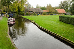 Giethoorn. Beautiful traditional house on a small island in a Dutch town of Giethoorn Stock Photography