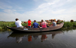 Giethoorn. The Netherlands - July 10, 2016: Unknown visitors in the sightseeing boating trip in a canal in .   is a idyllic city known as  Venice of the North Stock Image