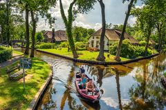 Tourists on a sightseeing boat in the village of Giethoorn, Netherlands Stock Images
