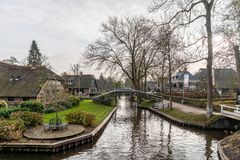 Beautiful green winter scene of narrow canals among residential buildings. stock photos