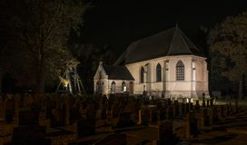 Church in Wanneperveen at Night. Giethoorn, The Netherlands - November 24, 2016: The church and the graveyard of Wanneperveen at night in Overijssel, Netherlands stock photography