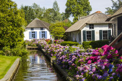 GIETHOORN, NETHERLANDS. Typical dutch county side of houses and gardens Stock Images