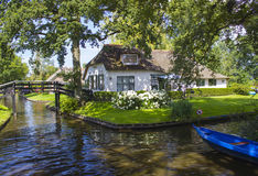 GIETHOORN, NETHERLANDS. Typical dutch county side of houses and gardens Stock Photography
