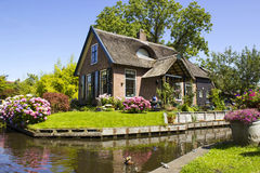 GIETHOORN, NETHERLANDS. Typical dutch county side of houses and gardens Stock Photos