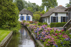 GIETHOORN IN NETHERLANDS. GIETHOORN, NETHERLANDS -typical dutch county side of houses and gardens royalty free stock images