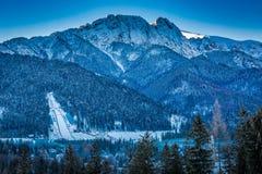 Giewont peak at dawn in Zakopane in winter, Tatra Mountains Stock Images