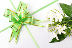 Gift. Top view - green gross ribbon and bow with flowers Royalty Free Stock Photo