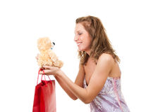 Gift. Girl received the gift of a teddy bear Stock Photography