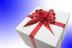 Gift. Box with red tape isolated on  white-blue  background Royalty Free Stock Image