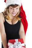 Gift. Woman holding a christmas gift isolated on white stock photography