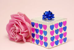 Gift. Box and rose on pink background Stock Photo