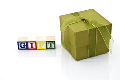 Gift. Green gift in white background Stock Photos