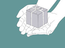 Gift. Hand holding a gift box Royalty Free Stock Images