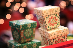 Gift. Colourful gift boxes  on defocused lights background Royalty Free Stock Photography