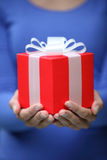Gift. A gift box in woman's hands stock photo
