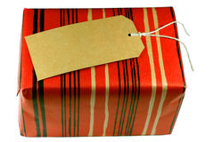 Gift. With Brown Label and Red Wrapper Royalty Free Stock Images