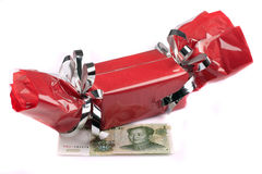 Gift. Chinese commerce (a red gift box with a suggestive Chinese bank note Royalty Free Stock Photo
